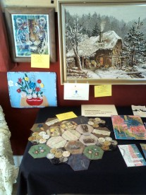 break o' day stitchers exhibition - my 'matriarchs' entry on table, lower left
